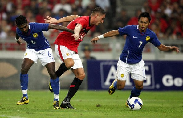 Federico Macheda of Manchester United is checked by V. Thirumurugam (L) and Mohd Aidil Zafuan of Malaysia XI during the pre-season friendly match between Manchester United and Malaysia XI at Bukit Jalil National Stadium on July 20, 2009 in Kuala Lumpur, Malaysia.