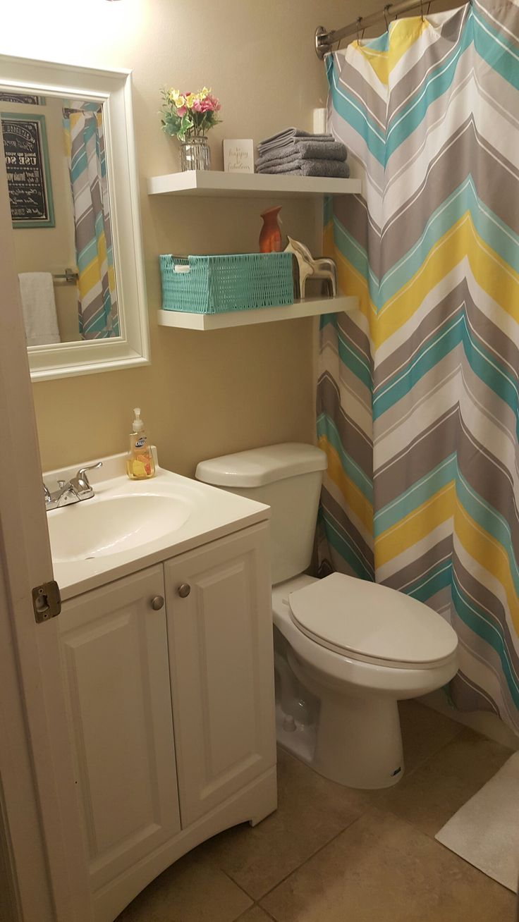 Small Bathroom Update Less Than 100 Lowe S And Hobby Lobby Yellow Teal
