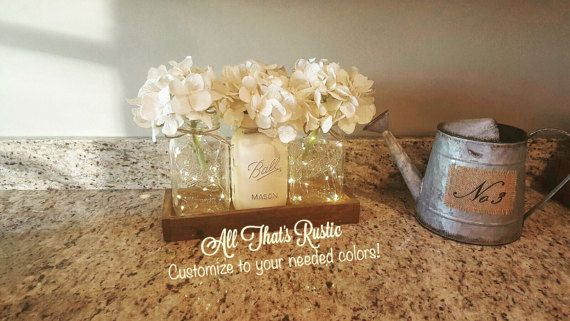 This listing is for a absolutely stunning Rustic Lighted Mason Jar Centerpiece! These make the perfect and unique look to any rustic home decor. These also make terrific Centerpieces for any event! Dont forget that it makes a one of a kind gift for any occasion as well! ;) These are