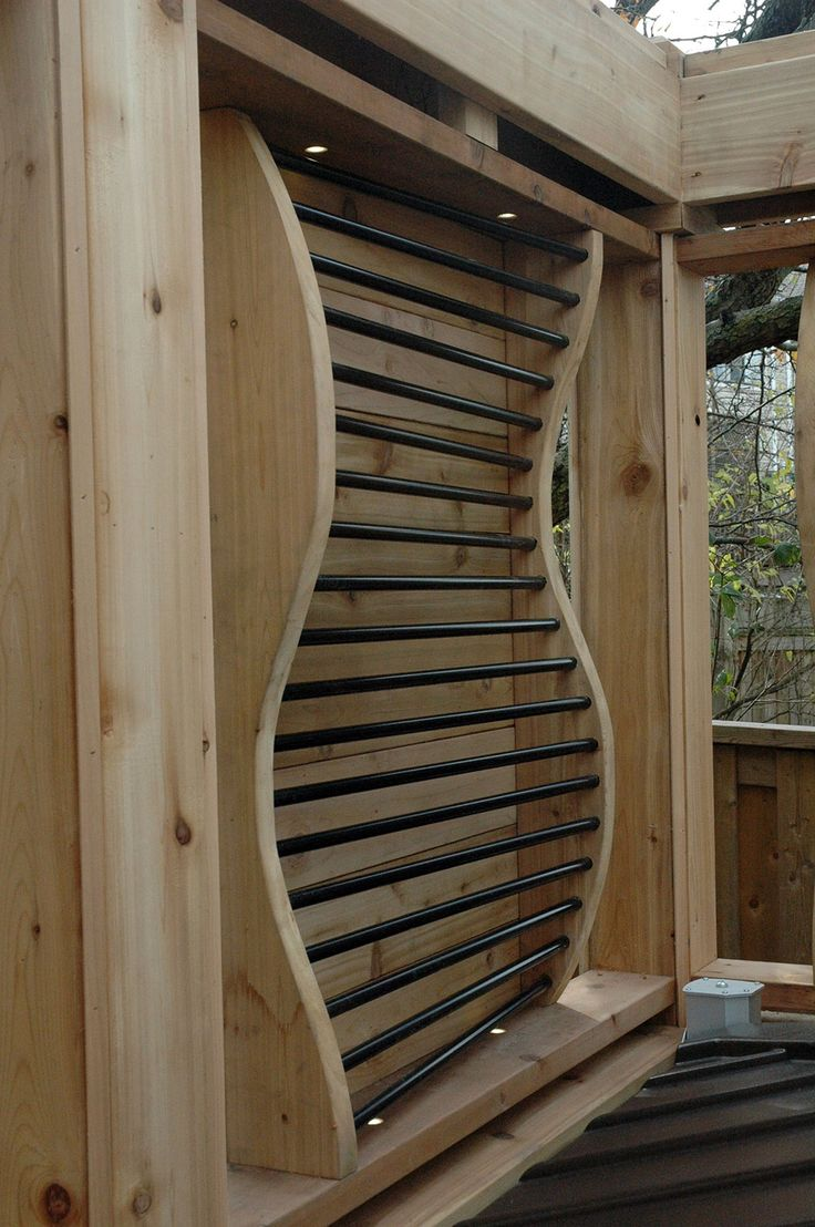 A Funky Curved Privacy Screen Accented With Metal Bars