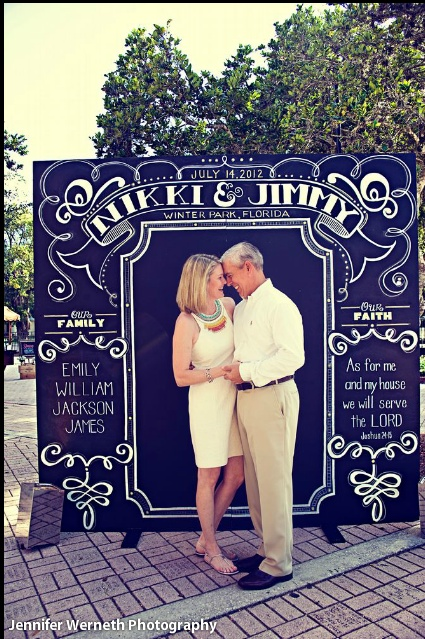 amazing chalkboard sign! Woah!! We could totally make. Aa is great at making things!!  And I can paint it!! This could be a fun backdrop for our guests to pose in front of for us to keep as our own wedding favor-ites!!