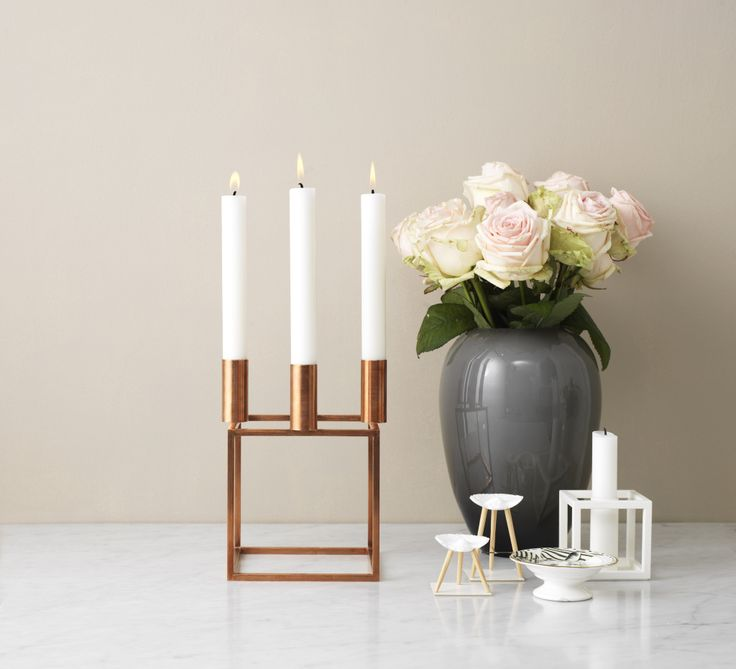Kubus Danish and Scandinavian Copper 4 Candleholder by Lassen. A modern and contemporary home decor accessory. Available online now!