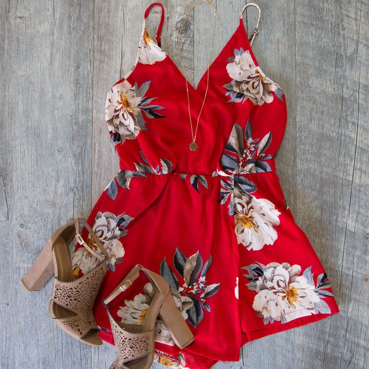 Suit up in our At Last Romper for every thing from date night to dance night! Woven fabric forms this flirty romper with a cross over surplice bodice, adjustable spaghetti straps, halter neckline, elastic waist and slip on styling. Elastic waist, and relaxed skort with asymmetrical hem.