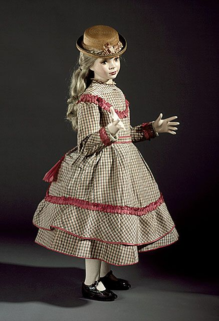 Girl's checked silk faille dress and overskirt with silk taffeta trim and glazed cotton lining, English or American, c. 1869.