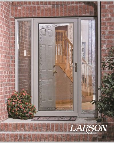 Adding a LARSON storm door with decorative glass detailing is a quick and easy way to update your entrance.Click to see all of our decorative glass options.   #WelcomeHome #MyLarsonDoor