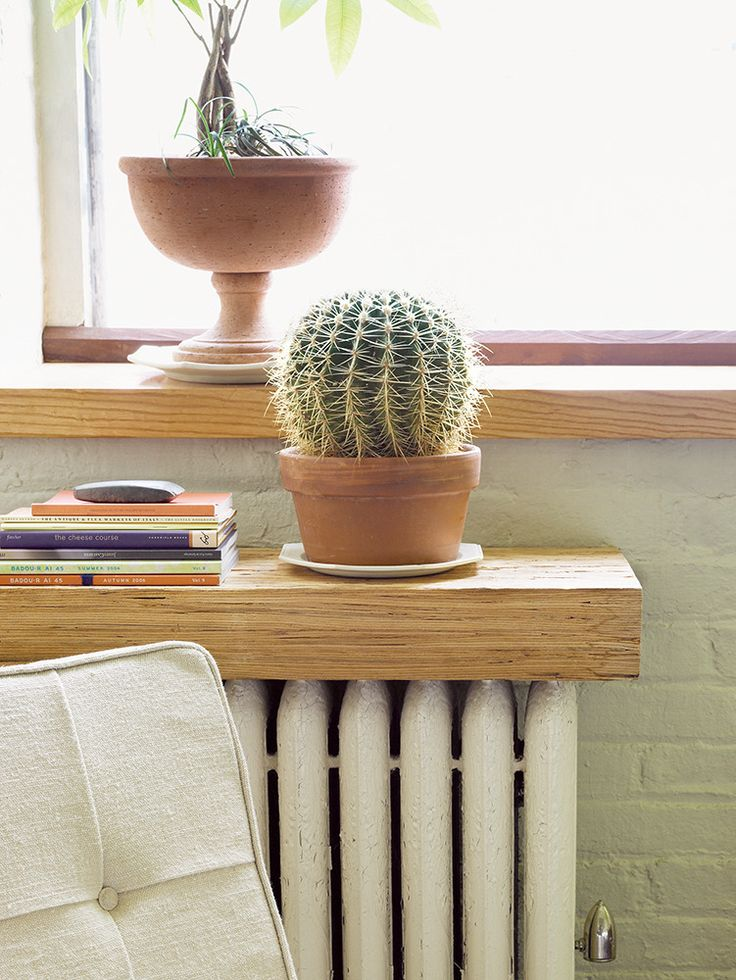 The top of a radiator can be the perfect place for a shelf. When a piece of wood or stone is placed on top, a bulky radiator becomes a handy side table or bookshelf. If you're using wood, just be aware that it might warp over time.