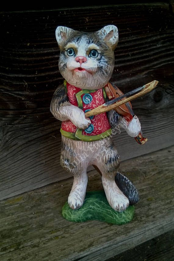 The cat who plays the violin. Wooden statue with a musical instrument. Carved from wood and painted, handmade