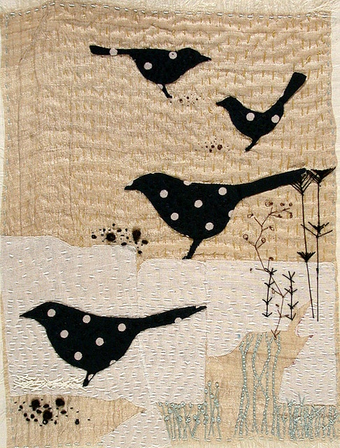 Blackbird art quilt - black with white polka dot birds, simple background with texturing from quilting