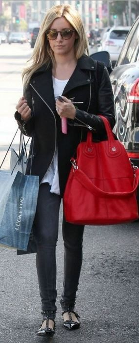 Who made  Ashley Tisdale's red leather handbag and black studded patent flat ballet flat shoes?