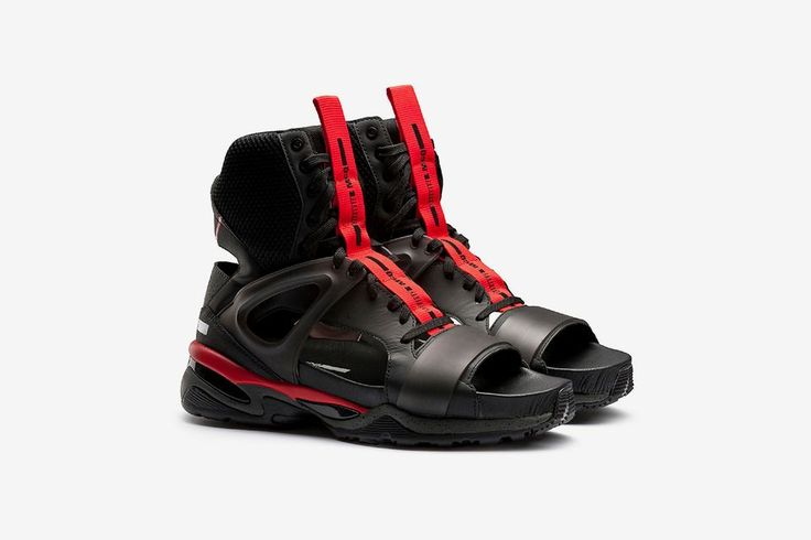 High-top sneaker sandal with mixed material upper and rubber sole.