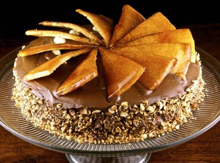 Dobos Torte. A Hungarian Cake. With chocolate buttercream and hazelnuts.