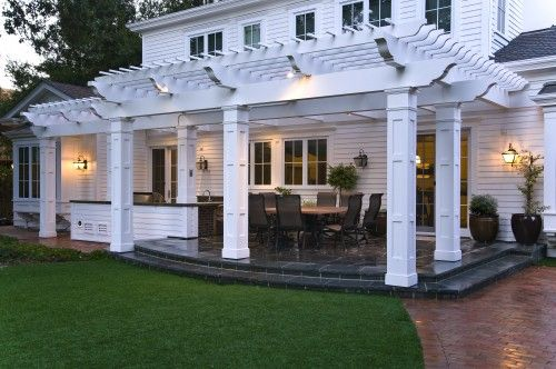 Pergola with contrasting mediums for outdoor living area vs. patio