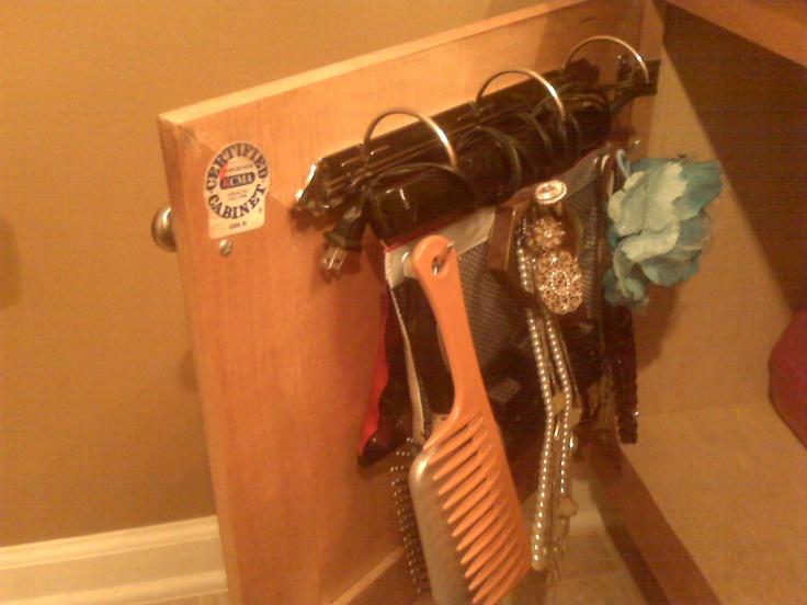 Dollar Design Diva:  Door Hook Racks and Portable Beauty Kit. Using a 2 inch binder mechanism. Perfect flat iron storage!