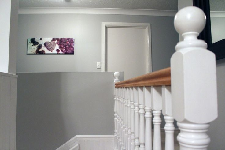 We are delighted with our decision to strip back the balustrade and paint the posts high gloss white.