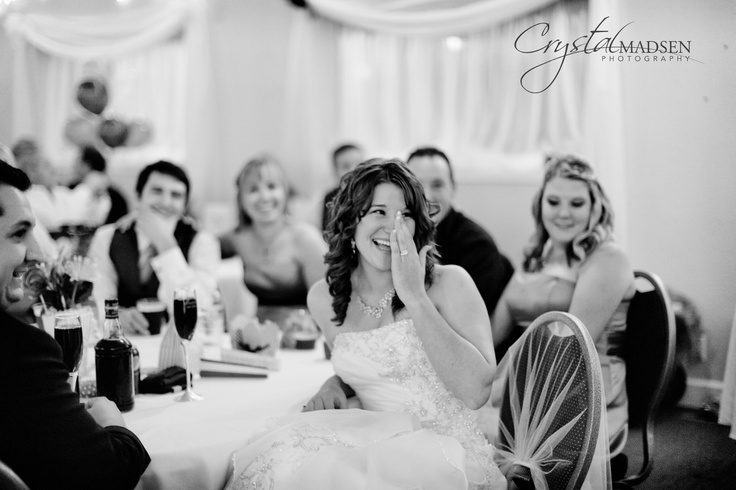 Best black and white candid wedding photo of a bride laughing.  Spokane Wedding Photographer Crystal Madsen Photography