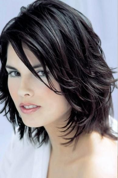 Black layered long bob haircut with long side swept piecey bangs hairstyle