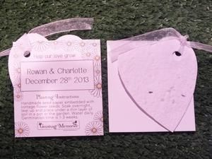 Personalised wedding favour with a seed paper shape and tag. Growing instructions are printed on the tag, including your name and date. the colours can be changed to match your wedding colours.