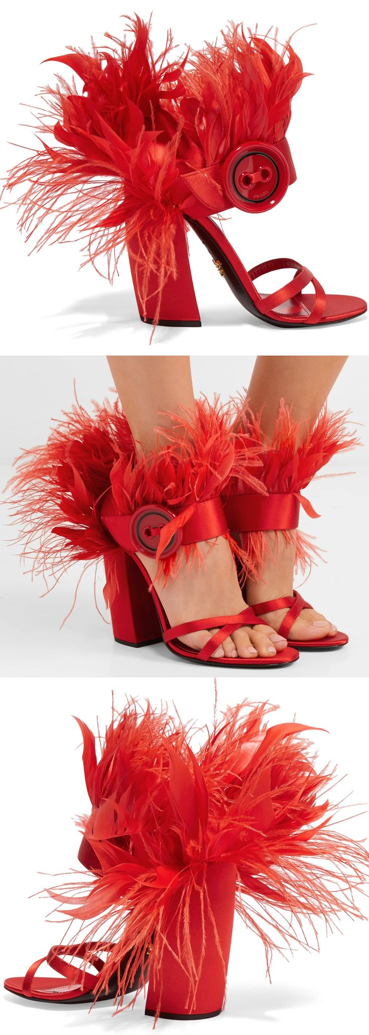 Feather-trimmed Satin Shoes - Sandals Red. Everyone's talking about beautiful ways designers are using feathers this season, and Prada defined the trend with its Fall '17 runway collection. These Italian-made sandals are embellished with red plumes, have an angled block heel and are decorated with an oversized button. For the show they were paired with midi skirt - styles that fall midi length work best. #feathers #frilly #shoes #shoesaddict #fallfashion #fashionista...