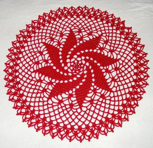 "Source: Star Doily Book No. 104, American Thread Company, 1953 . Thread: Aunt Lydia's Classic Crochet 10. Color: #494 Victory Red. Hook: Clover Soft Touch #2/1.50mm. Size: Abt. 14"" unblocked. Date made: June 12, 2009. For: Crochet Group project."