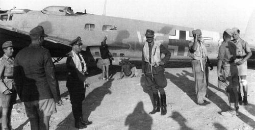Rommel's plane - The General Erwin Rommel, not yet Feldmarschall, arranging his life jacket in front to his personal aircraft, somewhere in Libya. Notice also two men with life jacket, surely a Rommel's staff officer at the center of the photo, and on the right a plane's crewmember speaking with other German servicemen.