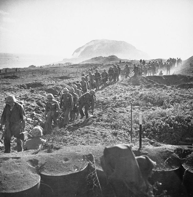 American Marines on the march during battle against Japanese for Iwo Jima during WWII.