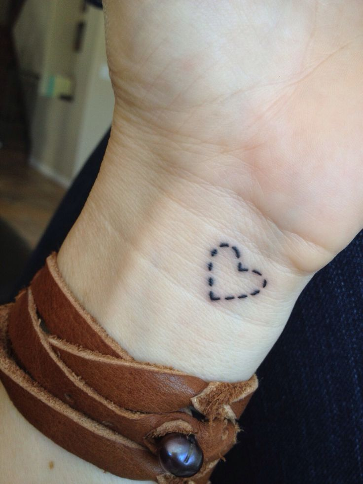 Small heart tattoo                                                       …