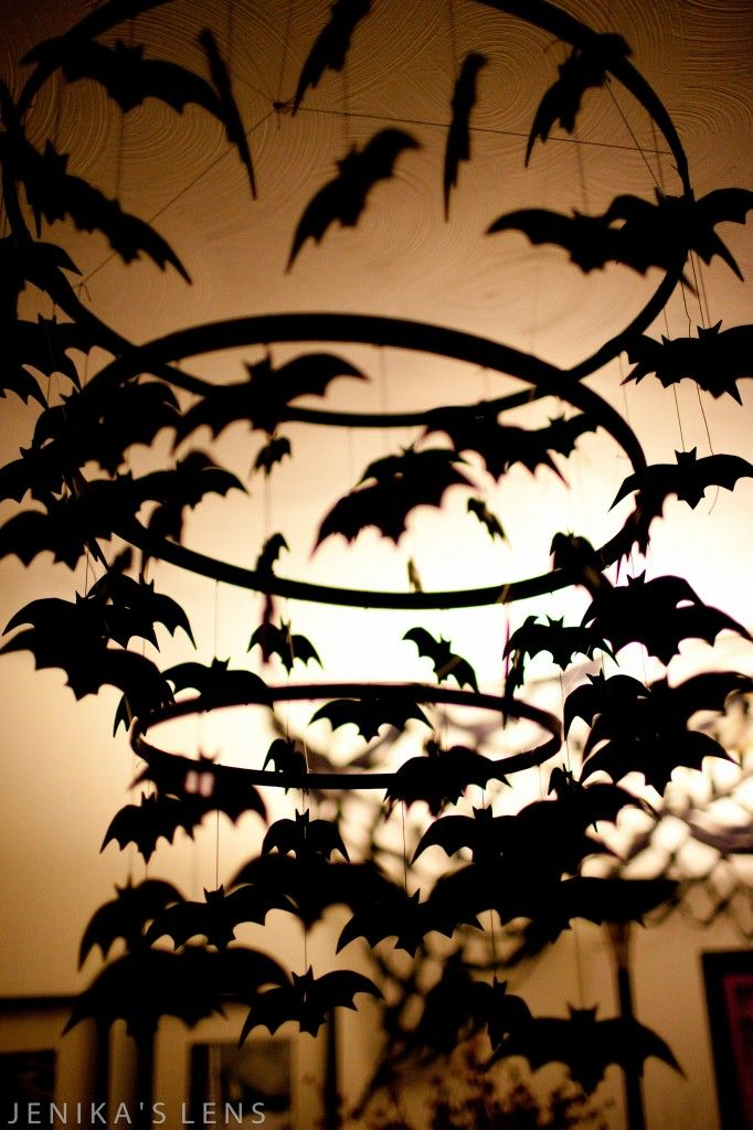 I.LOOOOOVE.THIS.!!! Halloween bat chandelier. TOTALLY making this this year!!!