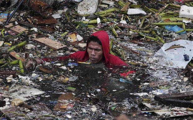 Philippine Typhoon News Today | ... poor community in Manila, Philippines Photo: AP Photo/Aaron Favila