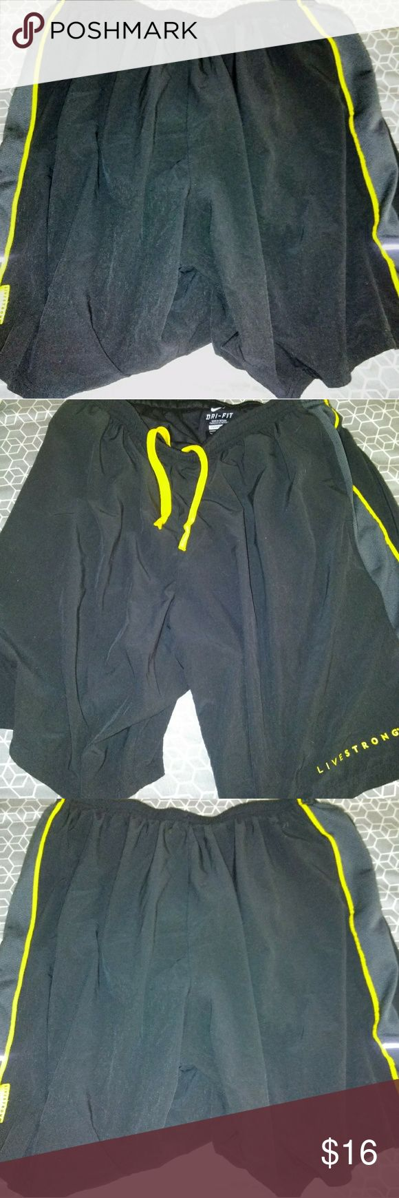 Men's Nike Livestrong Running Shorts Size Large These shorts are in good condition. Has a drawstring. side pockets,  and built in brief. Nike Shorts Athletic
