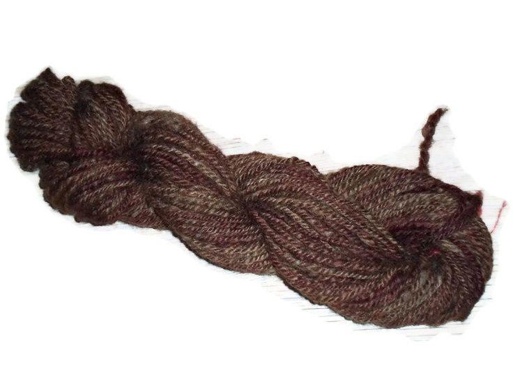 Handspun, hand dyed, worsted 3-ply yarn.