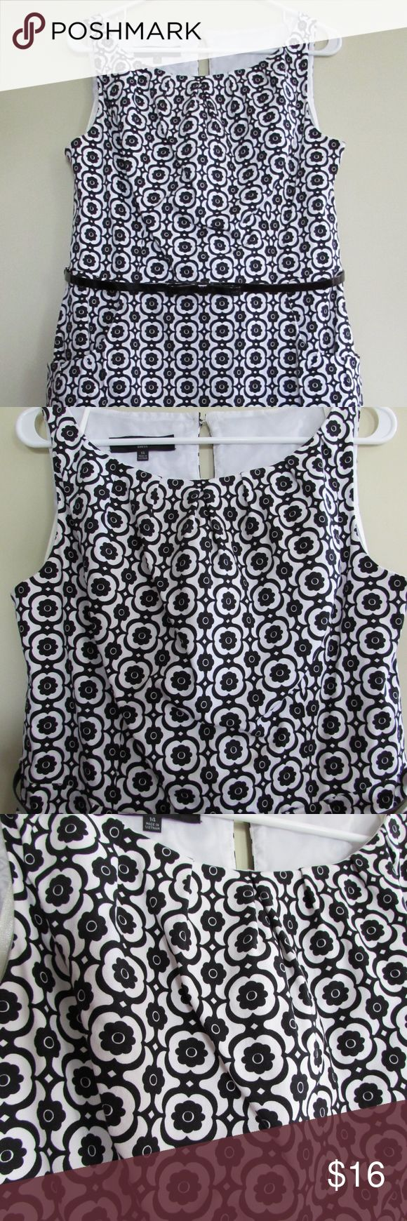 """Nine West Black White Floral Lattice Sheath Dress Adorable black and white cotton blend dress in a floral lattice design. Sleeveless, pleated neckline, front pockets, belt loops (belt is NOT included), keyhole back at neckline, side zip, fully lined, bra snap and back skirt vent; Adorable and VERY nice! Perfect with a black or colorful jacket for a holiday party!  Measures: 40"""" bust; 34"""" waist, 40"""" overall length, 23"""" skirt length. Ladies sz 14.  Condition: EUC. Overall NICE. Nine West…"""