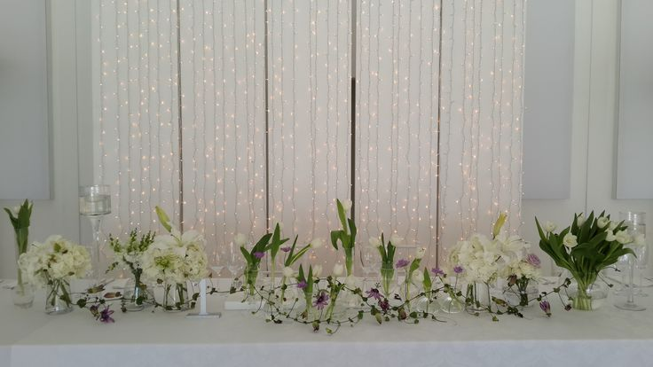 Modern Bridal table with fairy light backdrop #passiflora #tulips #roses