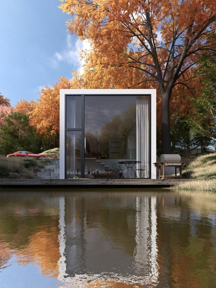 le minimalisme en architecture, une jolie maison avec murs en verre au bord du lac
