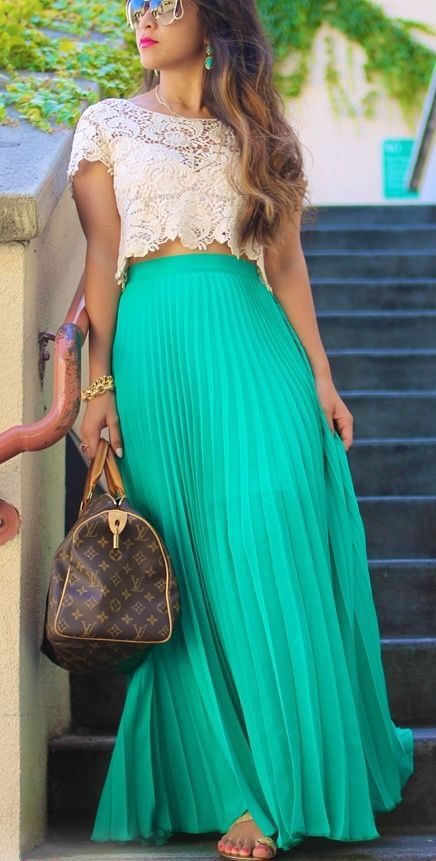 Lace crop top & green maxi skirt.