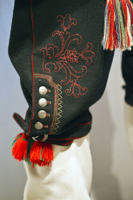 Norwegian folk costume -Stitching is NOT considered 'impressive' if not Hand Made.  Though cheap technology would speed up the process, it's not respected -- since the one outfit is so special, (Kind of like bringing home KFC for Thanksgiving -- You gotta really cook -- here, ya really gotta embroider. )
