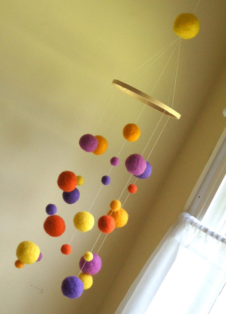 Needle Felted Gumball Mobile - Purples and Oranges. $60.00, via Etsy.