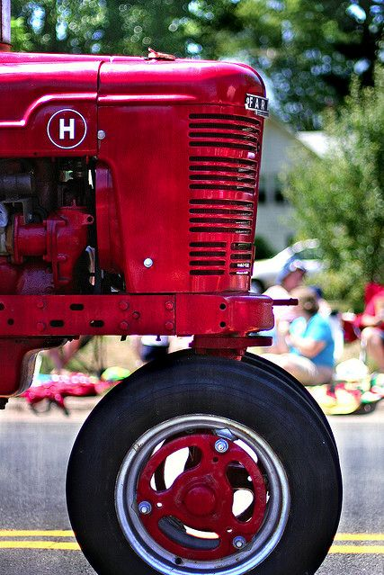 Red Tractor...perhaps at a parade,                                        hey ill have more pics coming soon once i go up to Rantaul il and decater for tractor shows, might see big bud this yr - hayden(duramax lover)