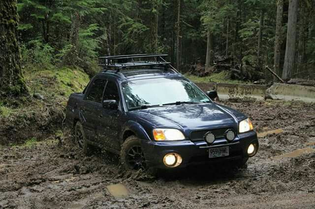 Subaru Baja playing in the mud