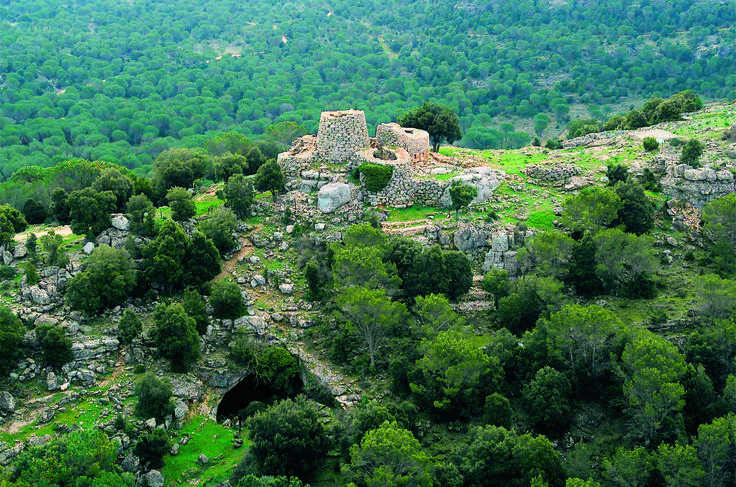 An aerial view of nuraghe Serbissi's towers in Osini. One of the two entrances of the cave below is visible.  #Ogliastra #Sardinia #italy