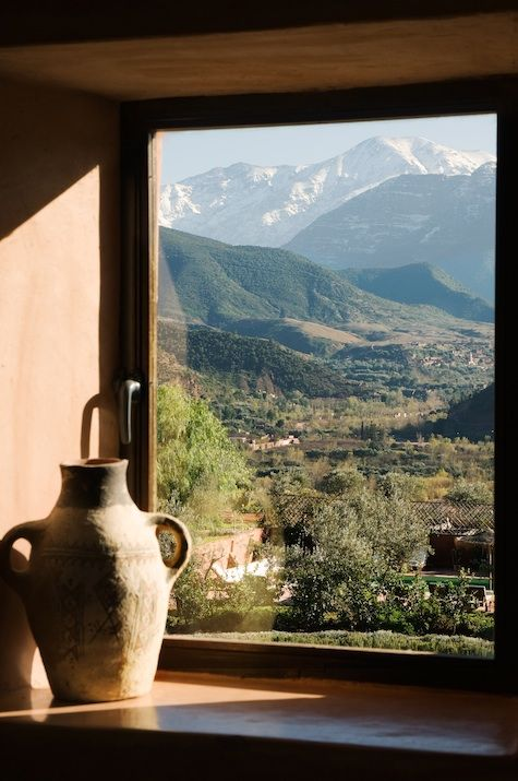 Kasbah Bab Ourika in Morocco. View of surrounding Atlas Mountains..  www.asilahventures.com.
