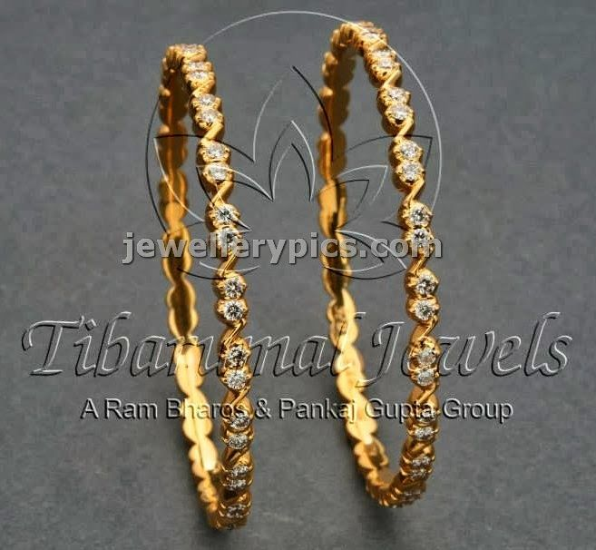 Diamond bangle designs at tibarumal jewellers. pretty models made with 22 carta gold sleek and slender designs   To buy mail to ...