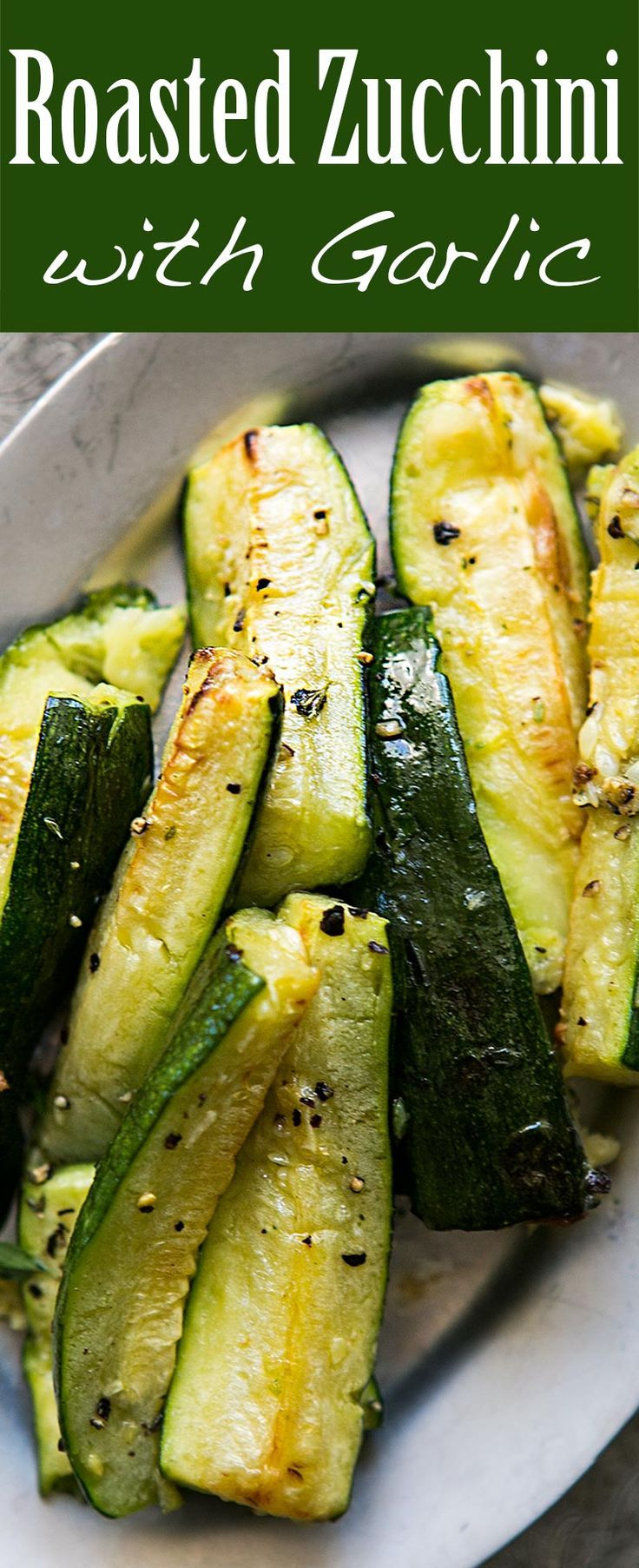 Easy roasted zucchini recipe! fresh zucchini, cut lengthwise, oven-roasted with olive oil, garlic, black pepper, and Herbes de Provence. #vegan #paleo
