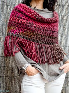No pattern, but really lovely wraps and ponchos on this site.