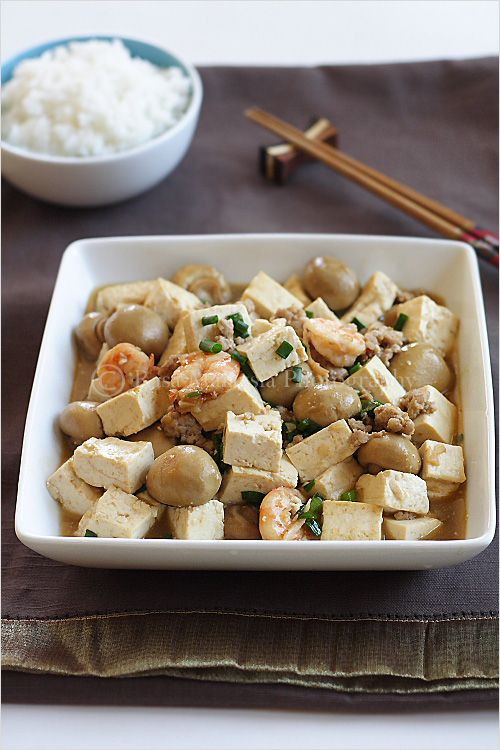 Home-style Tofu Recipe (Tofu with Mushrooms): is a homey dish, an everyday and humble dish. In Chinese, it's called 家常豆腐. Every family has their own interpretation or recipe of home-style tofu.  My home-style tofu is really simple: a block of tofu, some mushrooms (I used canned button mushrooms),  ground pork, and shrimp.  The sauce is the popular Chinese brown sauce that consists of oyster sauce and soy sauce.