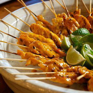 Grilled Chicken Skewers with Asian Sweet Chili BBQ Glaze - grilled juicy marinated chicken tenders skewered on bamboo sticks basted with a tangy-sweet honey mustard BBQ grilling glaze spiked with Asian sweet chili sauce.