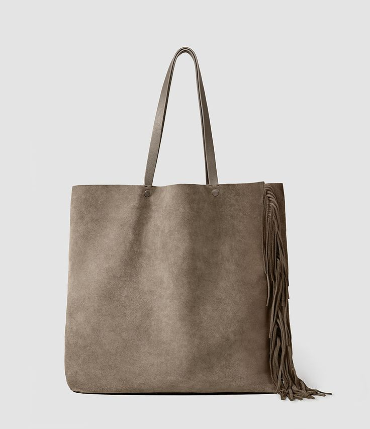 $298, allsaints.com From the experts on effortless cool, this Allsaints tote bag features asymmetric fringe details along the front and back. A leashed interior zip pouch keep your belongings extra secure.  - BestProducts.com
