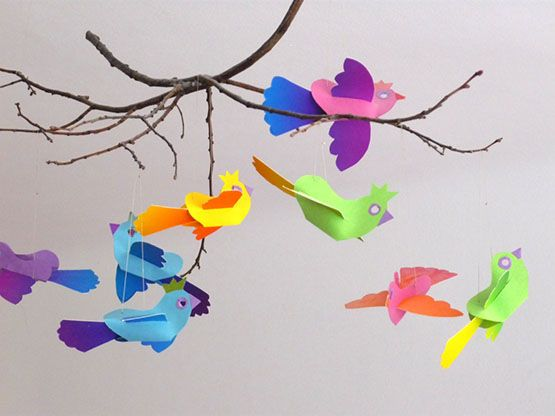 Rainbow colored birds are flying in the kids room