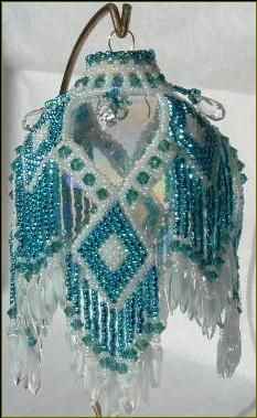 Teal Diamonds ornament stitched by Susan H. She was inspired by a pattern for earrings.