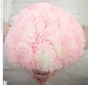 I actually wouldn't mind these flowers, either. I like that they still fluffy and whimsical #weddingbouquet #footballmums