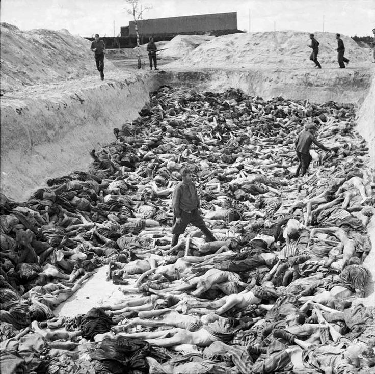 Dr Fritz Klein, the camp doctor, standing in a mass grave at Belsen. Klein, who was born in Austro- Hungary, was an early member of the Nazi Party and joined the SS in 1943. He worked in Auschwitz-Birkenau for a year from December 1943 where he assisted in the selection of prisoners to be sent to the gas chambers. After a brief period at Neungamme, Klein moved to Belsen in January 1945. Klein was subsequently convicted of two counts of war crimes and executed in December 1945. APR  15 1945…